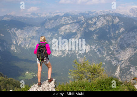 Girl enjoying view over Julian Alps from mount Vogel, Slovenia. Lake Bohinj is largest permanent lake located in Bohinj Valley of Julian Alps, Triglav National Park, Slovenia - Stock Photo