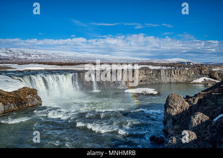 15 April 2018: Godafoss, Iceland - Godafoss, the Waterfall of the Gods, a major tourist attraction in Iceland. A large party of visitors has just arri - Stock Photo