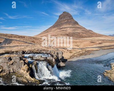 16 April 2018: Snaefellsnes Peninsula, West Iceland - The mountain Kirkjufell and waterfall Kirkjufellsfoss on the Snaefellsnes Peninsula, Iceland... - Stock Photo