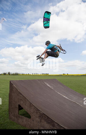 Extreme sport kite landboarding, Essex, UK. Airborne jump. - Stock Photo