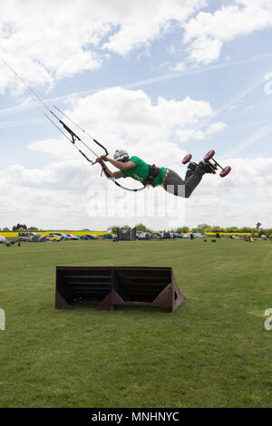 Extreme sport kite landboarding in Essex, UK. Airborne jump. - Stock Photo