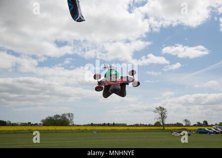 Extreme sport kite landboarding in Essex, UK. Going airborne. - Stock Photo