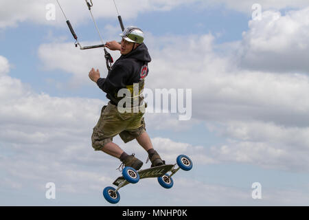 Extreme sport kite landboarding in Essex, UK. Airborne. - Stock Photo
