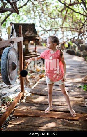 Casual portrait of little girl outdoors on summer day - Stock Photo