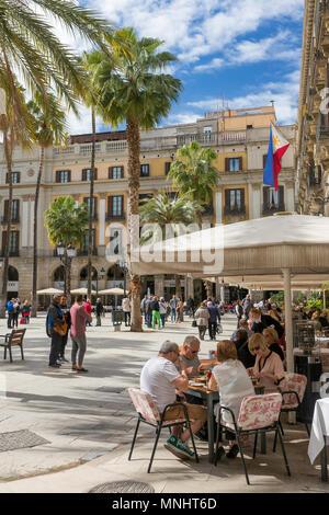 Barcelona, Spain - March 27, 2018: Outdoor restaurants at famous Placa Reial in Barcelona, Spain