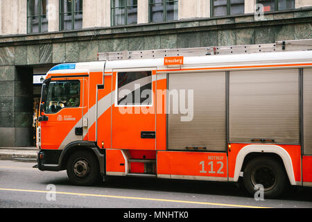 Berlin, Germany 15 February 2018: modern German fire truck moving on the street in the city - Stock Photo