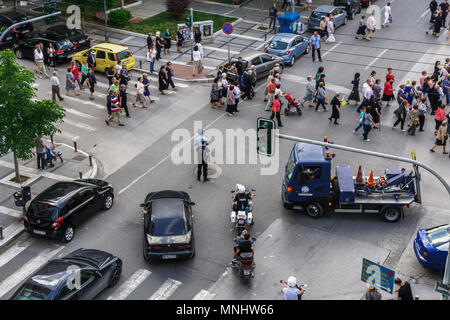 Greek Police blocking street traffic at Thessaloniki. Hellenic police law enforcements stop traffic to allow crowd pass at Orthodox church procession. - Stock Photo
