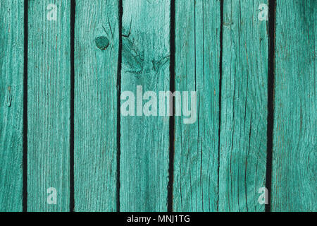 Texture of old boards painted in green color - Stock Photo