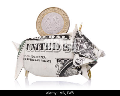 Turkish lira under the protection of the world currency. American dollar in the form of a piggy bank isolated on a white background - Stock Photo