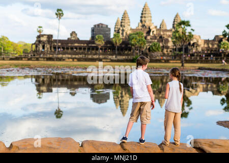 Kids at ancient Angkor Wat temple in Siem Reap in Cambodia - Stock Photo