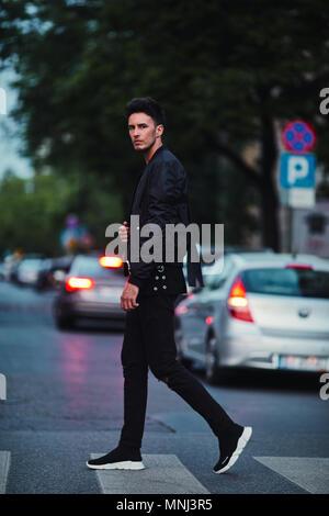 Portrait of stylish man on night city background pose to camera - Stock Photo