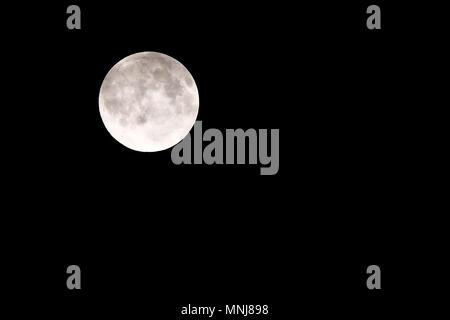 Full moon over dark black sky - Stock Photo