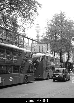BT Tower (Post Office Tower), from Tottenham Court Road, London, with London Buses and Taxi in the foreground - Stock Photo
