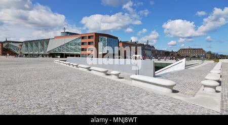 The underground Danish Maritime Museum next to the Culture Yard in Elsinore / Helsingør, Denmark. Bollards around the museum signal a morse code. - Stock Photo