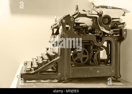 Old typewriter in antique photography vintage simulated. side view. toned filter - Stock Photo
