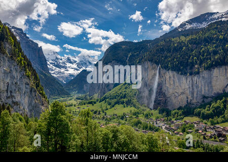 View of Lauterbrunnen with Staubbach Falls, Interlaken-Oberhasli, Bern, Switzerland - Stock Photo