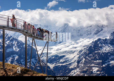 People on the observation platform at the top of First mountain above Grindelwald, Bernese Oberland, Switzerland - Stock Photo