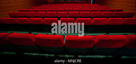 red velvet armchairs in the movie theater - Stock Photo