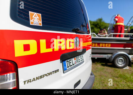 Delmenhorst / Germany - MAY 6, 2018: German VW Volkswagen Transporter from DLRG Wasserrettung stands on a meadow. DLRG Wasserrettung means German Life - Stock Photo