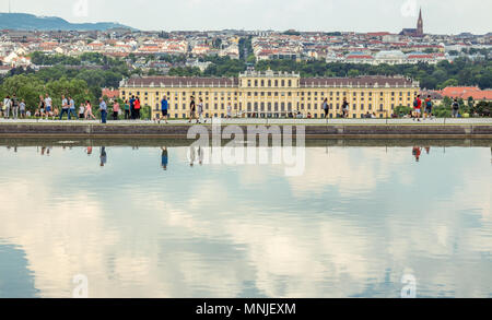 Vienna Austria May.10 2018, Schonbrunn castle view from Gloriette at low with the pond reflecting the sky against cityscape - Stock Photo