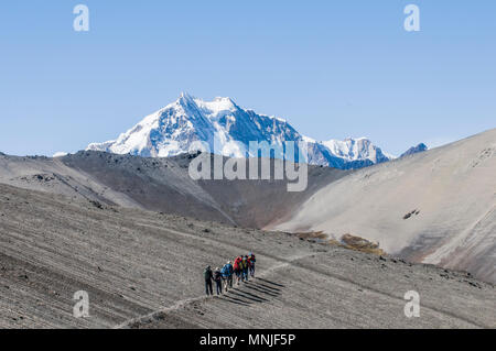 Treking in the Cordillera Real region of the Bolivian Andes with Huayan Potosi in the distance. - Stock Photo