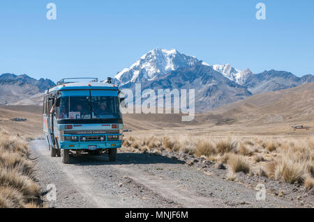 A local bus transporting hikers in the Cordillera Real region of the Bolivian Andes. - Stock Photo