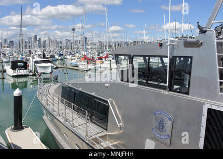 New Zealand costume boat mooring in Westhaven Marina against Auckland skyline.It provide border control and protect from potenti - Stock Photo