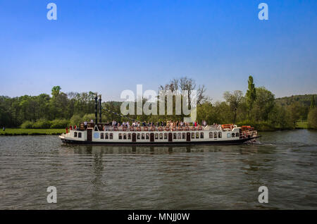 OXFORDSHIRE, UK - MAY 06, 2018: Paddle wheel Boat at Henley on Thames. Henley is overlooked by a beautiful chiltern landscape of wooded hills. - Stock Photo