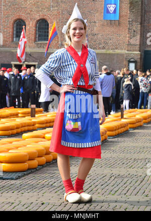 Dutch girls in traditional  costume at the cheese market in Alkmaar Cheese Market, Holland 'cheese girls' sells samples at the Alkmaar Cheese market - Stock Photo