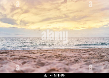 The golden time for colourful beach sunset with yellow, golden sky and cloud, stunning natural phenomenon, Skyscape from the beach, Sunset on beach - Stock Photo