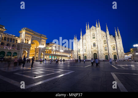MILAN, ITALY - APRIL 28th, 2018: turists during blue hour taking pictures in Duomo Square , the main landmark of the city. - Stock Photo