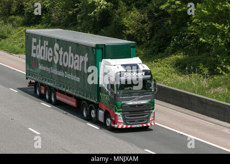 Eddie Stobart heavy goods & commercial traffic, haulage, lorry, transportation, truck, cargo, vehicle, delivery, transport, industry, freight on the M6 southbound, UK - Stock Photo