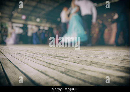 Blurred Background. Silhouettes of Dancing Couples on the Stage. - Stock Photo