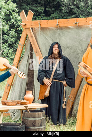 RITTER WEG, RUSSIA, MOROZOVO, APRIL 2017: Festival of the European Middle Ages. Monks in long black cape cloak with hood on traditional medieval celeb - Stock Photo