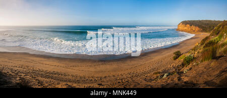 Panorama of excellent surf at Bells Beach, Torquay, Surf Coast Shire, Great Ocean Road, Victoria, Australia, early morning - Stock Photo