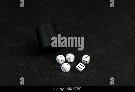 Closeup of 5 dice used for gambling on a table - Stock Photo