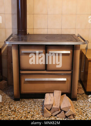 old wood burning stove in the kitchen of an house in Europe - Stock Photo