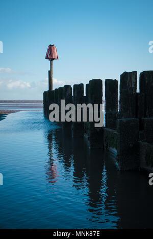 Groyne and sea defences, Cleethorpes beach - Stock Photo