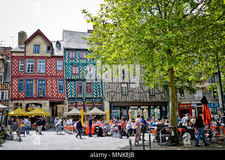 Rennes (Brittany, north-western France): buildings and cafe terraces in the city centre, 'place Sainte-Anne' square. Colorful facades of old half-timb - Stock Photo