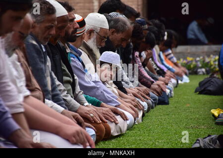 Kashmiri Muslims prays on the first Friday of the holy fasting month of Ramadan in the garden of Jamia Masjid or Grand Mosque, in Srinagar, Indian Kashmir.  Islam's holiest month of Ramadan is a period of intense prayer, dawn-to-dusk fasting and nightly feasts. - Stock Photo