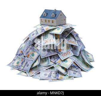 House on Top of a Mound of Cash Isolated on a White Background. - Stock Photo