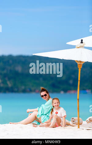 Mother and daughter enjoying tropical beach vacation - Stock Photo