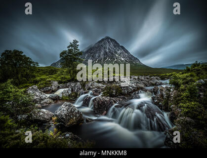Buachaille Etive Mòr. meaning 'the great herdsman of Etive' is a mountain at the head of Glen Etive in the Highlands of Scotland. Its pyramidal form,  - Stock Photo