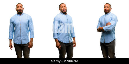 African american man with beard crying depressed full of sadness expressing sad emotion - Stock Photo