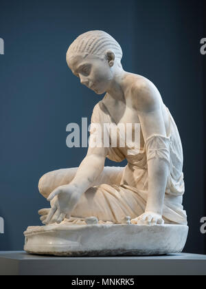 Berlin. Germany. Girl Playing Astragaloi (Knucklebones), Roman sculpture from around 150 AD, head ca. 200 AD. Altes Museum, found on the eastern slope - Stock Photo