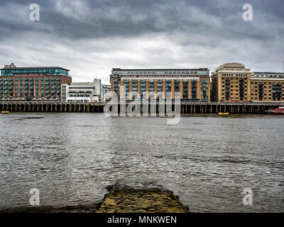 Butlers Wharf on the south side of the river Thames, viewed from the North shore, London, UK. - Stock Photo