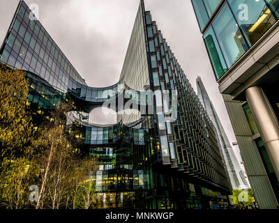 PWC (PricewaterhouseCoopers) building, Southwark, London, UK designed by Foster and Partners with The Shard in the background. - Stock Photo
