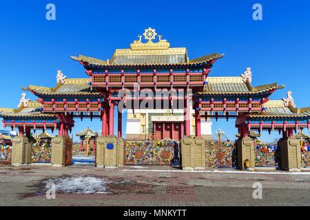 Gate to Buddhist complex Golden Abode of Buddha Shakyamuni in spring. Elista. Kalmykia. Russia - Stock Photo