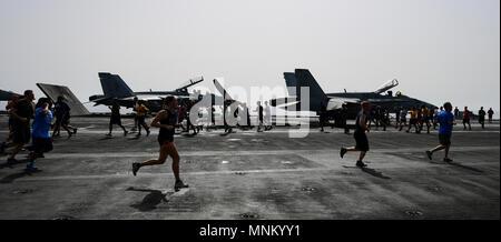 5d66435d8 ... ARABIAN GULF (March 16, 2018) Sailors and Marines run on the flight deck