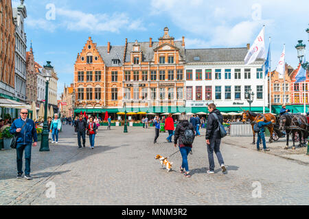 BRUGES, BELGIUM - APRIL 23, 2018: The Markt of Bruges in the heart of the city is a popular tourist spot. - Stock Photo